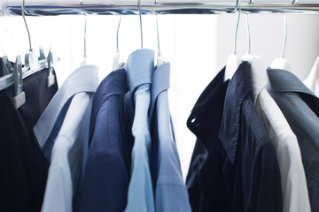 Male shirts hanging on a rack