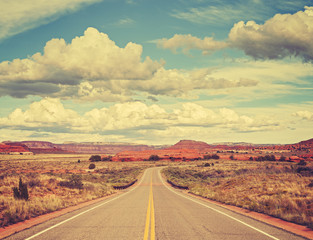 Vintage old film stylized country road, travel concept.