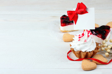 cake with jam and cookies in the shape of heart on wooden table