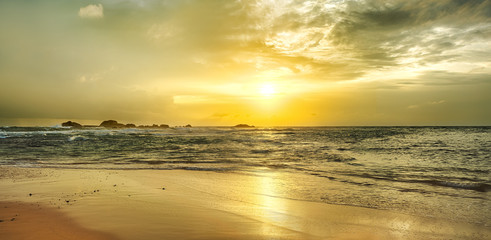Golden sunset over the sea. Panorama