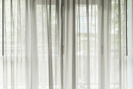 White see through window curtain in a home
