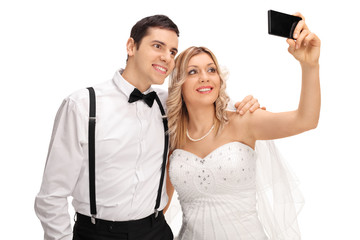 Newlywed couple taking a selfie with phone