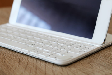 Great white tablet with modern keyboard at office