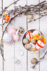 Easter eggs in bucket, decorativerabbit  and willow  branches on