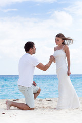 Proposal on beach, engagement