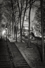 Stairs leading to the Basilica of the Sacred Heart (Sacre Coeur Basilica) at night in Montmartre - Black and White, Paris, France