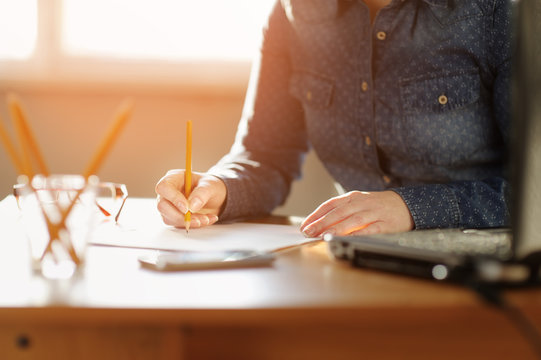 Freelancer woman working with documents.