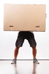 Delivery man holding a paper box.
