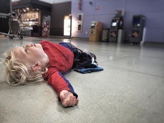 Boy waiting at the airport