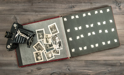 Vintage camera and phot album with old pictures