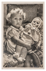 Little girl playing with a big doll. Vintage picture