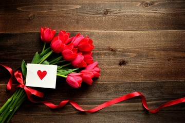 Red tulip bouquet with red heart message card