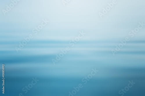 Wall mural Abstract clear blue water in blurred background concept
