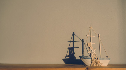 Sailboat model on table.