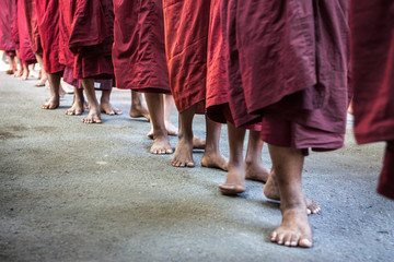 a lot of walking monks bare feet on the ground