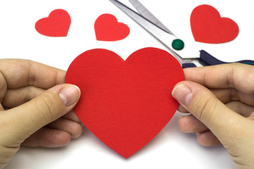 Creating red heart of colored paper pattern