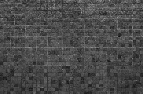 Grey and black mosaic wall texture and background..