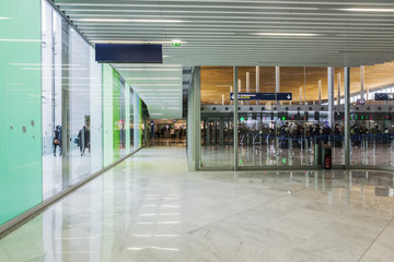Connecting corridor in green glass hall.