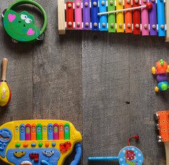 Toy Musical instruments collection on old wooden table