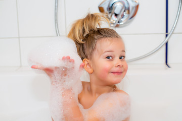 funny girl with foam bathtub in the bathtub