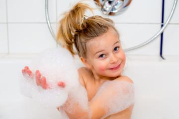funny girl with foam bathtub in the bathtub