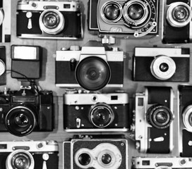 Old vintage cameras background, B&W