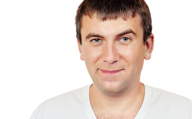 Smiling man with a raised eyebrow on a white background