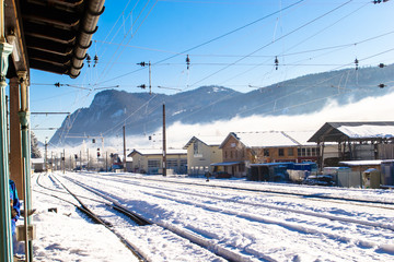 A railway station covered with snow in the mountains.