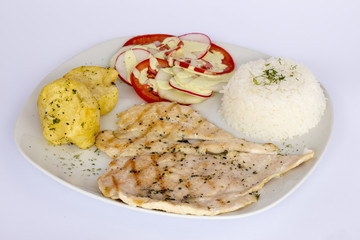 Grilled chicken fillets, potatoes and vegetablesm Peruvian dish.