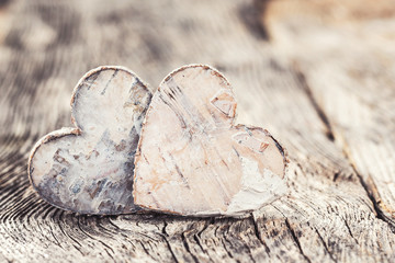 Valentines Day background. Two hearts on wooden background. Toned, selective focus