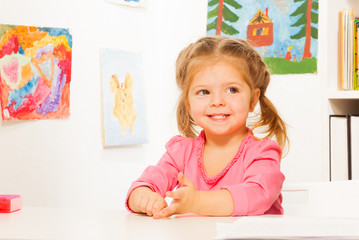 Cute little girl doing her lessons at the desk