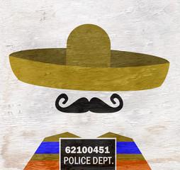 mugshot of man wearing sombrero on wood grain texture
