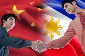 Handshake with flag of China and Philippines