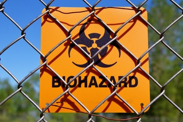 Biohazard Sign. Biohazard sign attached to a chain link fence.