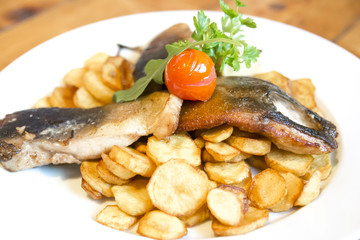 Fried carp fillet with fried potatoes