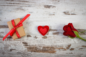 Wrapped gift with ribbon, red heart and rose for Valentines Day