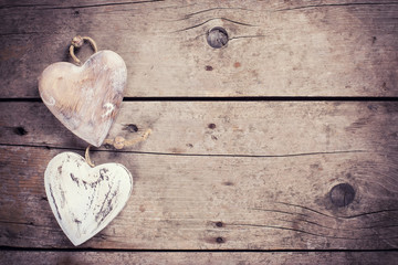 Two  rustic decorative  hearts on vintage wooden background