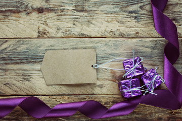 three gift boxes and purple ribbon