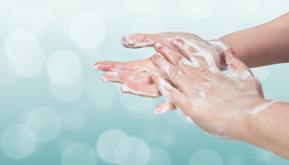 Washing hands. Hygiene concept. Blue bokeh background.