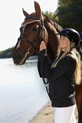 Outdoor portrait of horse and rider