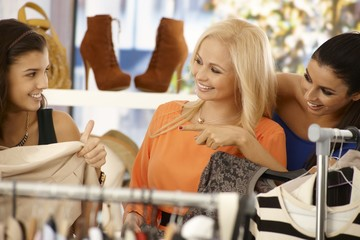 Young women shopping at clothes store