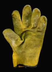 Old work Glove isolated on black background