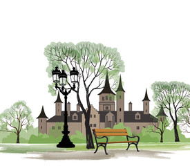 Bench in park with old castle behind. Garden landscape with street light