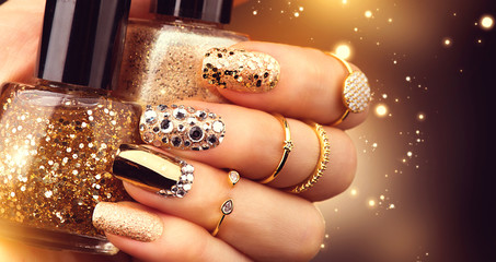 Printed kitchen splashbacks Manicure Golden manicure with gems and sparkles. Bottle of nailpolish, trendy accessories