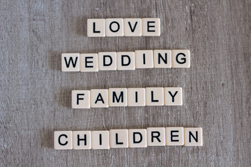 Words connected to love and family formed with plastic letters