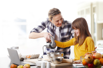 Mother and daugther cooking together