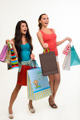 Two pretty girls with shopping bags.