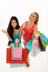 Happy smiling women with shopping bags.