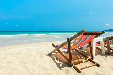 Wall Mural - Beach chair for relaxation on the beach
