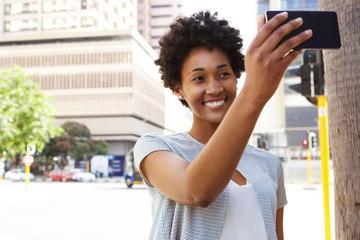 Happy african woman taking a selfie